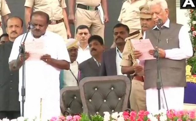 http://firstindianews.com/photos/Photos-of-HD-Kumaraswamy-during-the-swearing-in-ceremony-51181528