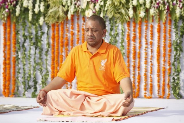 http://firstindianews.com/photos/Chief-Minister-Yogi-Adityanath-yoga-saffron-t-shirt-in-Lucknow-2026038459